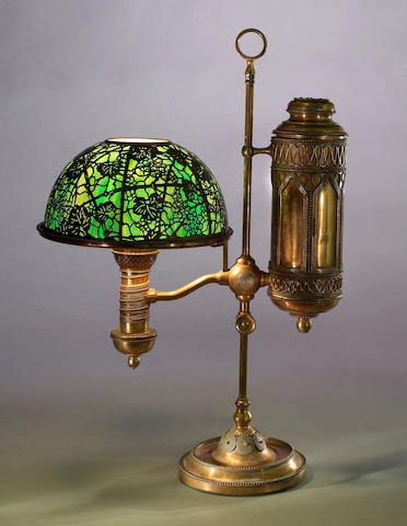 A Tiffany Studios Favrile glass and copper student lamp