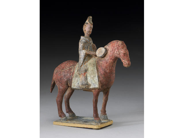 A painted pottery horse and rider <i>Northern Wei Period</i>