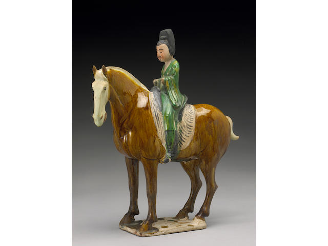 A <i>sancai</i> glazed model of a horse and rider <i>Tang Dynasty</i>