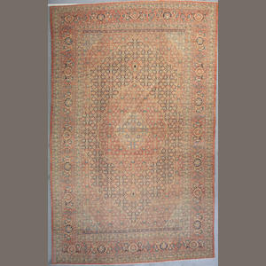 A Tabriz carpet Northwest Persia Size approximately 18ft 8in x 11ft 6in