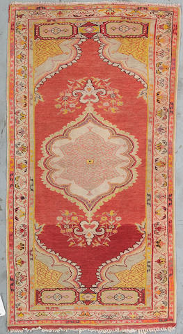 An Oushak rug West Anatolia Size approximately 6ft 3in x 3ft 3in