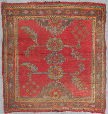 An Oushak rug West Anatolia Size approximately 4ft 8in x 4ft 8in