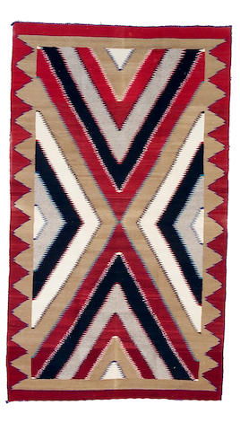 A Navajo rug, 6ft 8in x 3ft 11in