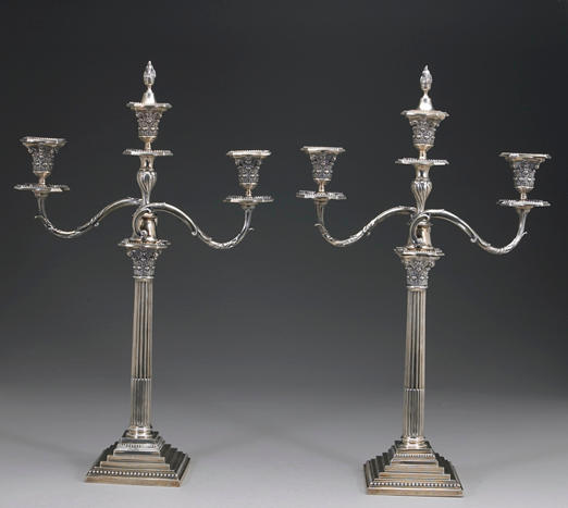 A Victorian silver pair of Corinthian columnar candlesticks