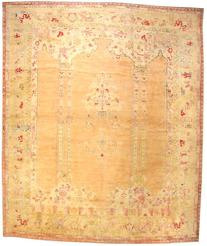 An Oushak carpet West Anatolia, Size approximately 13ft 2in x 15ft 9in