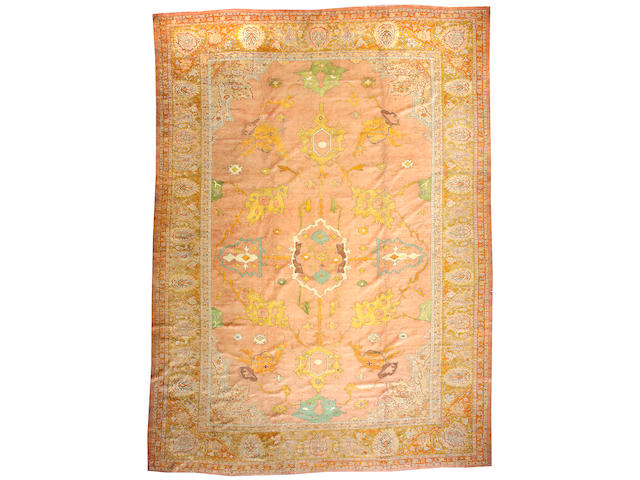An Oushak carpet West Anatolia, Size approximately 13ft 5in x 18ft 7in