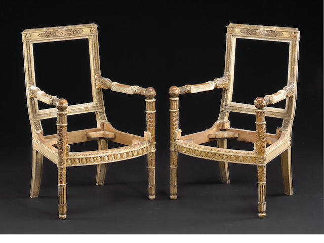 A pair of Empire style painted and parcel gilt fauteuils a la reine