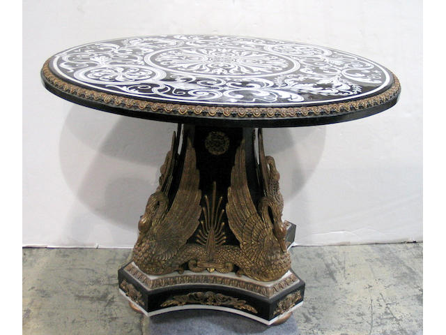 A Neoclassical style specimen marble table with parcel gilt figural base