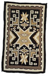 A Navajo Two Grey Hills rug, 5ft 11in x 3ft 7in