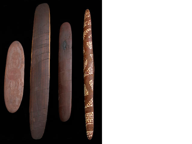 Three Aboriginal shields and a wood churinga