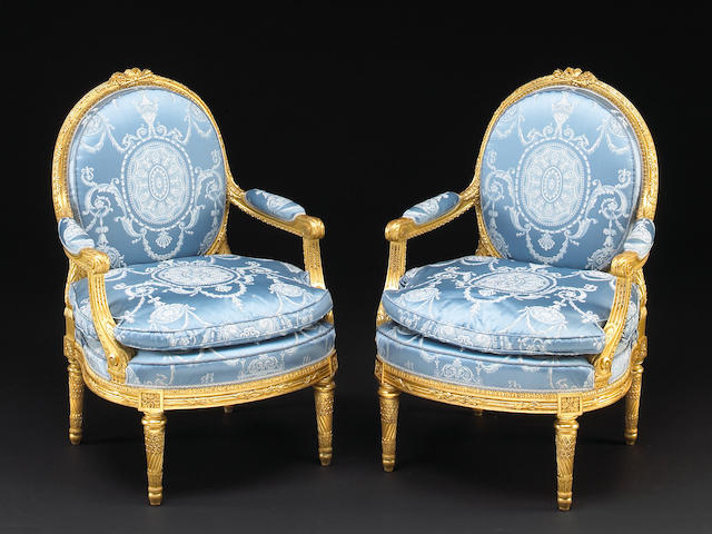 àA pair of Louis XVI style giltwood fauteuils à la reine