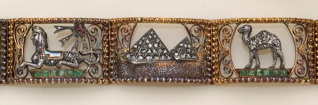 An Egyptian revival diamond, gem-set, eighteen karat gold and silver bracelet,