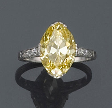 A natural fancy color diamond, diamond and platinum ring,