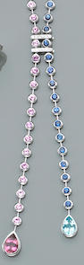 A sapphire, pink tourmaline, blue topaz, diamond and eighteen karat white gold necklace