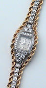 A lady's Hamilton, USA gold, platinum and diamond, integral bracelet wristwatch,