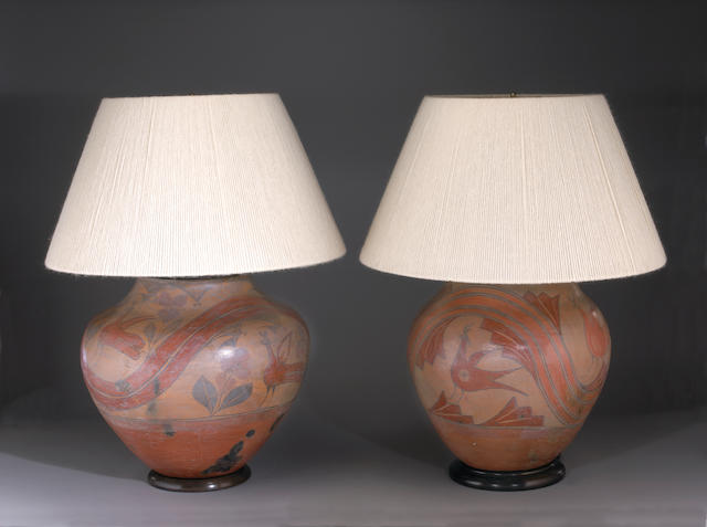 A pair of monumental terracotta pots, mounted as lamps