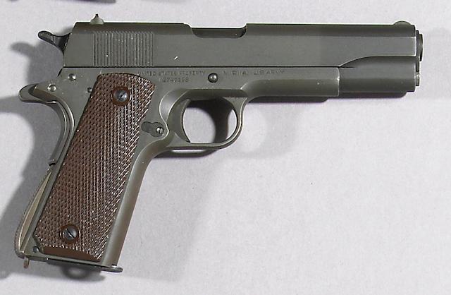 A U.S. Colt Model 1911A1 semi-automatic pistol Curio or Relic firearm