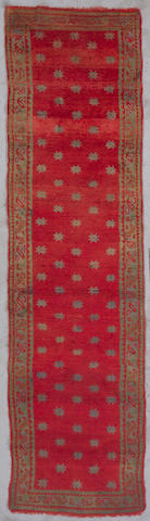 An Oushak runner West Anatolia, Size approximately 3ft 1in x 11ft 9in