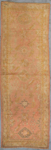 An Oushak runner West Anatolia, Size approximately 4ft 2in x 12ft 2in