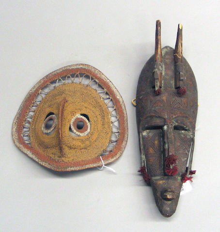 Two ethnographic masks: Maprik and Marka