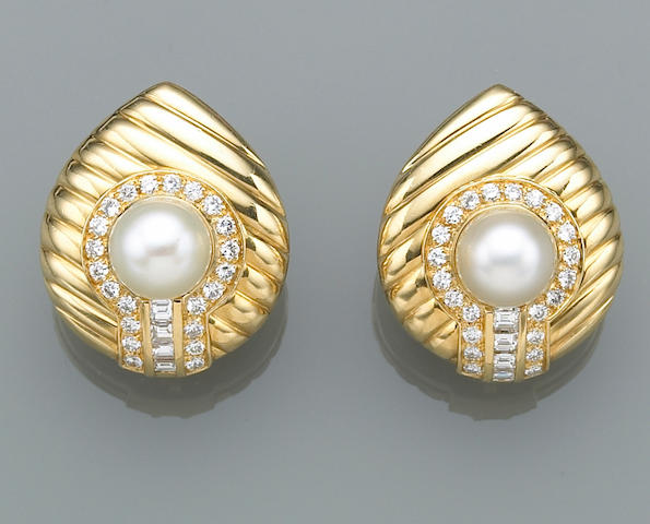 A pair of cultured pearl, diamond and eighteen karat gold clip earrings