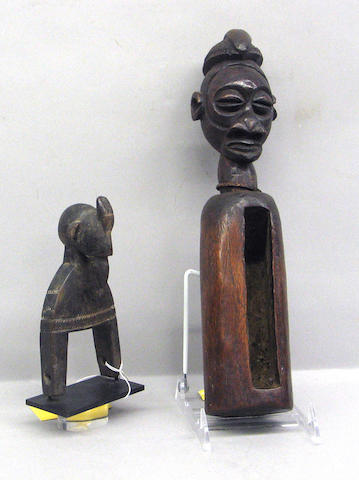 Two African items: heddle pulley, slit drum
