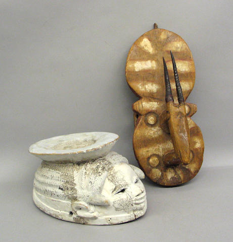 Two African masks: Yoruba, Gurunsi