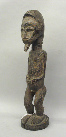 A Baule male figure