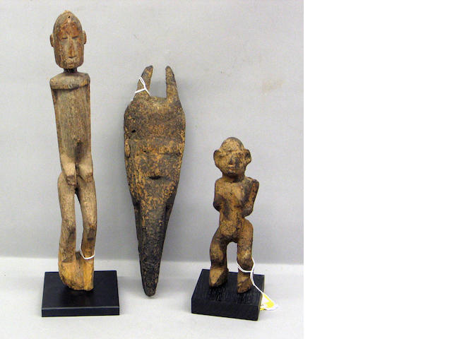 Three African items: mask and two figures