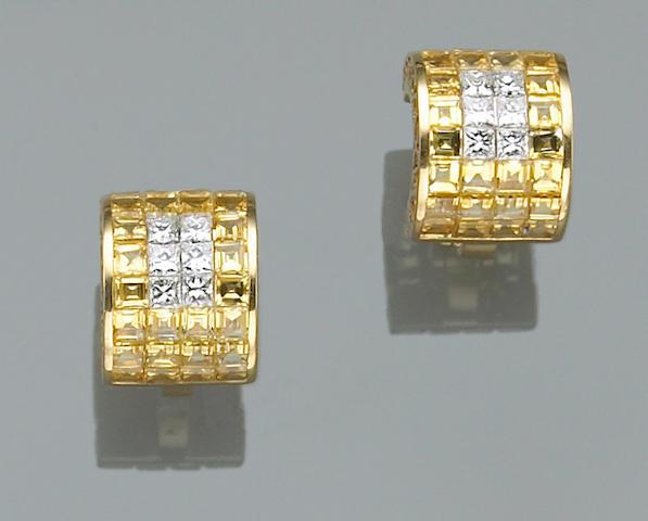 A pair of yellow sapphire, diamond and eighteen karat gold earrings