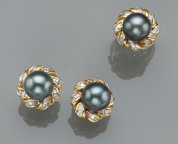 A set of black South Sea cultured pearl, diamond and eighteen karat gold ring and pair of earrings