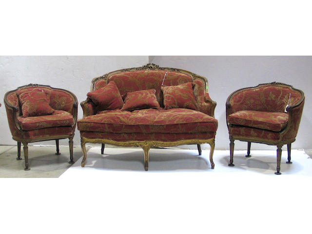 A Louis XV style parcel gilt assembled salon suite  comprising a settee and two bergeres