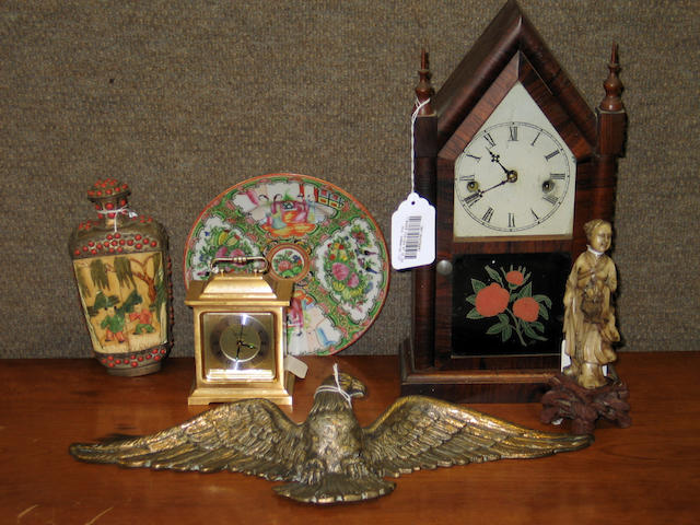 A large assembled grouping of decorative items including porcelains, a steeple clock, jewelry boxes, costume jewelry, a pair of eagle bookends, marble bases, Asian ceramics and metal works, etc.