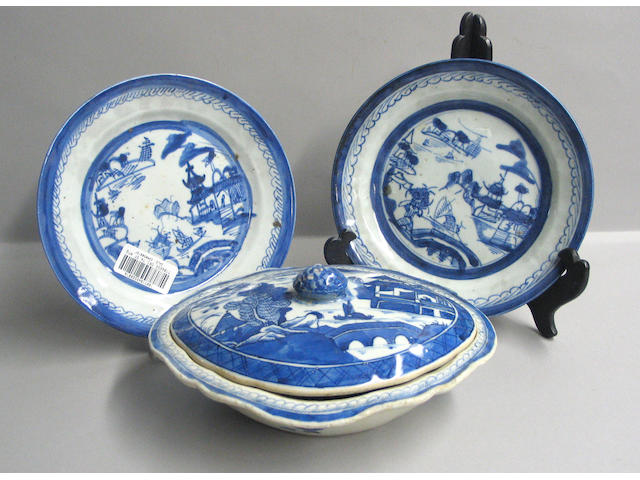 An assembled set of seventy-four Canton blue and white porcelain export dinnerware