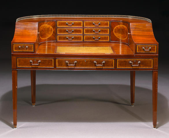 A George III style inlaid mahogany desk of Carlton House form