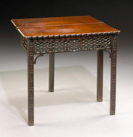 A George III mahogany fold top tea table