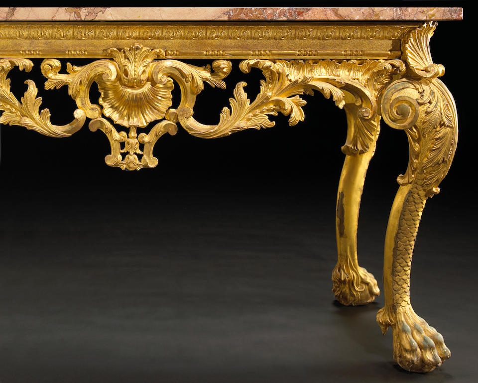 A pair of George II carved gilt pine console tables