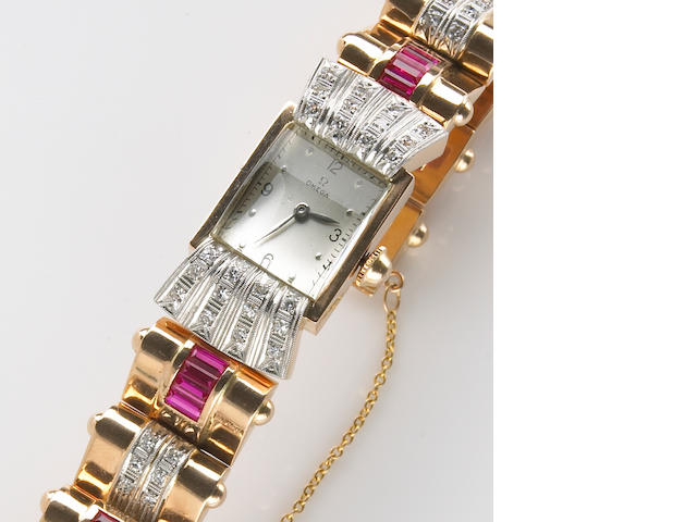 A lady's Omega, Swiss retro gold, diamond and ruby, integral bracelet wristwatch,