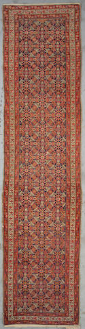 A Malayer runner Central Persia Size approximately 13ft x 3ft 8in