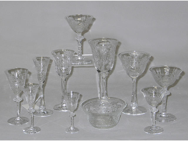 A suite of American rock crystal stemware together with a partial set in a similar pattern