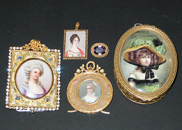 Four gilt bronze mounted portrait miniatures, together with an amethyst colored brooch