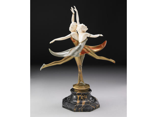 A cold-painted bronze and ivory group: Butterfly Dancers