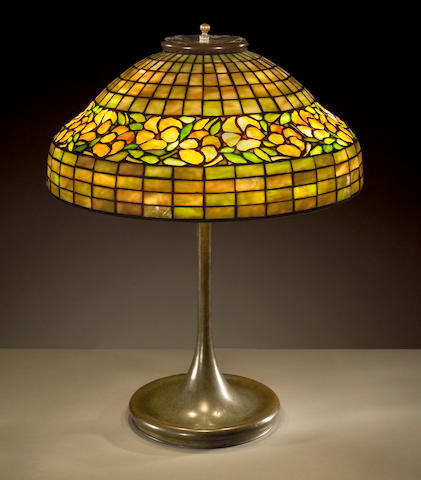 An American leaded glass and patinated-metal lamp