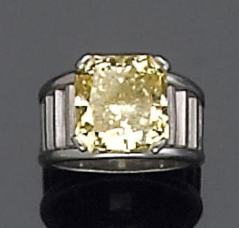 A natural fancy color diamond and platinum ring