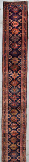 A Lilihan runner Central Persia, Size approximately 22ft 6in x 2ft 10in