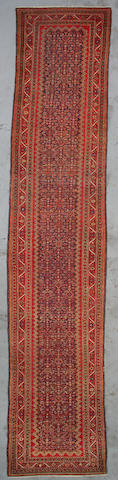 A Malayer runner Central Persia, Size approximately 17ft x 3ft 5in