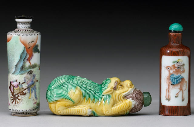 Five porcelain snuff bottles, four cylindrical and one molded as a fu dog