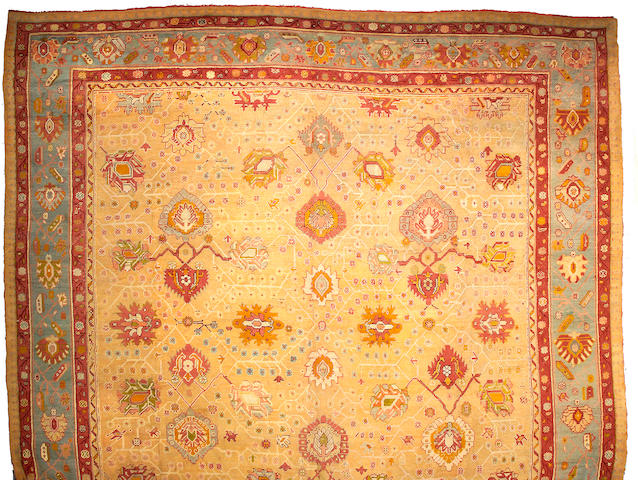 An Oushak carpet West Anatolia, Size approximately 17ft 7in x 17ft 7in
