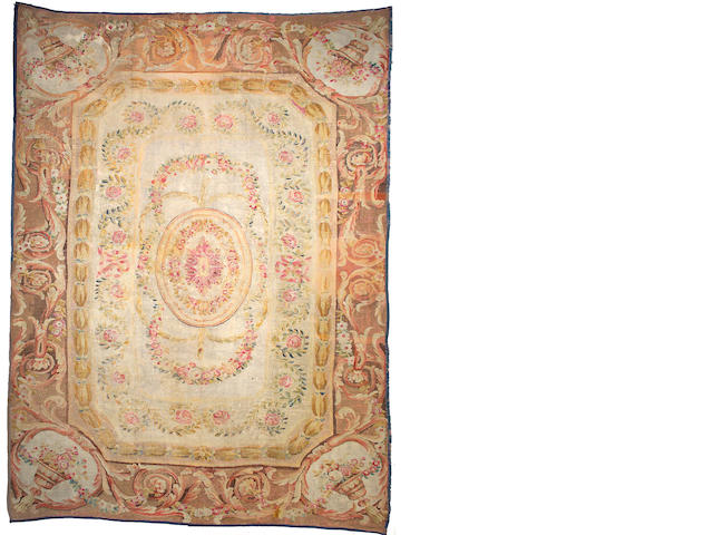 An Aubusson carpet France, Size approximately 16ft 8in x 12ft 2in