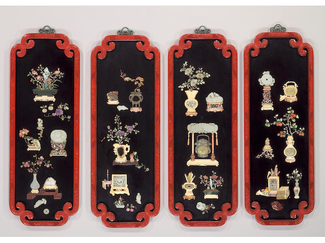 A set of four black and carved cinnabar lacquer wall panels with overlay decoration